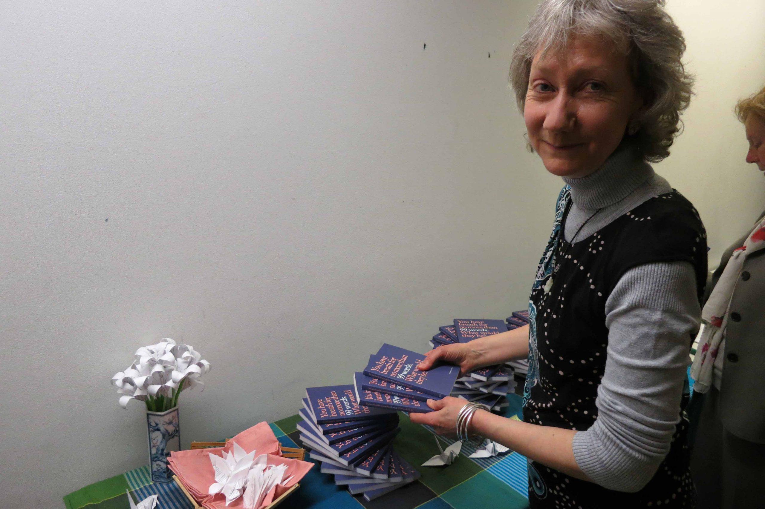 Liz with her book 99 Words